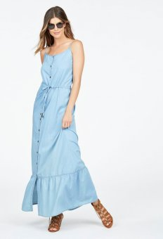 a lady putting on a denim maxi gown, gladiators and sunglasses.