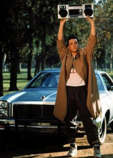 Lloyd Dobler wearing a trenchcoat in 'Say any such thing' keeping boombox floating around